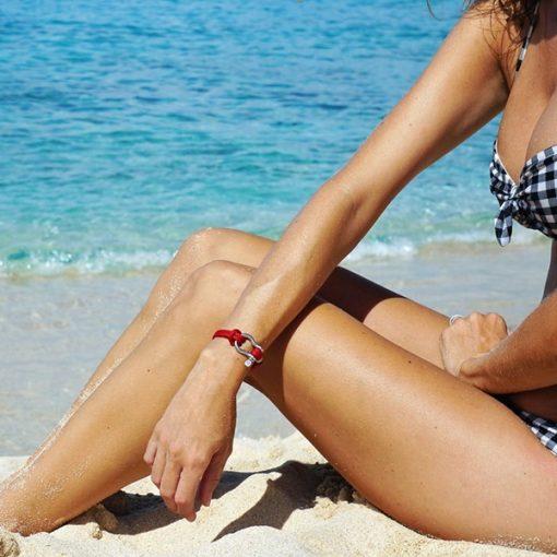 Girl in a bikini modeling our red shackle bracelet